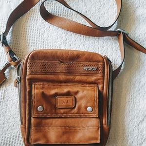 TUMI leather crossbody